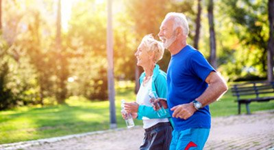 Older couple running in the park