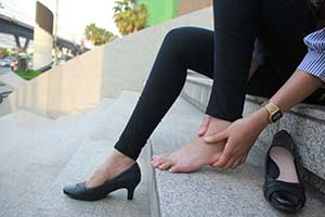 Plantar Fasciitis in woman foot.