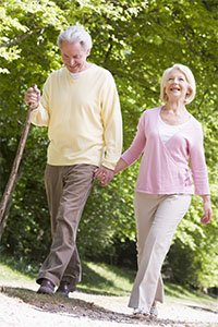 picture of mature couple strolling through park
