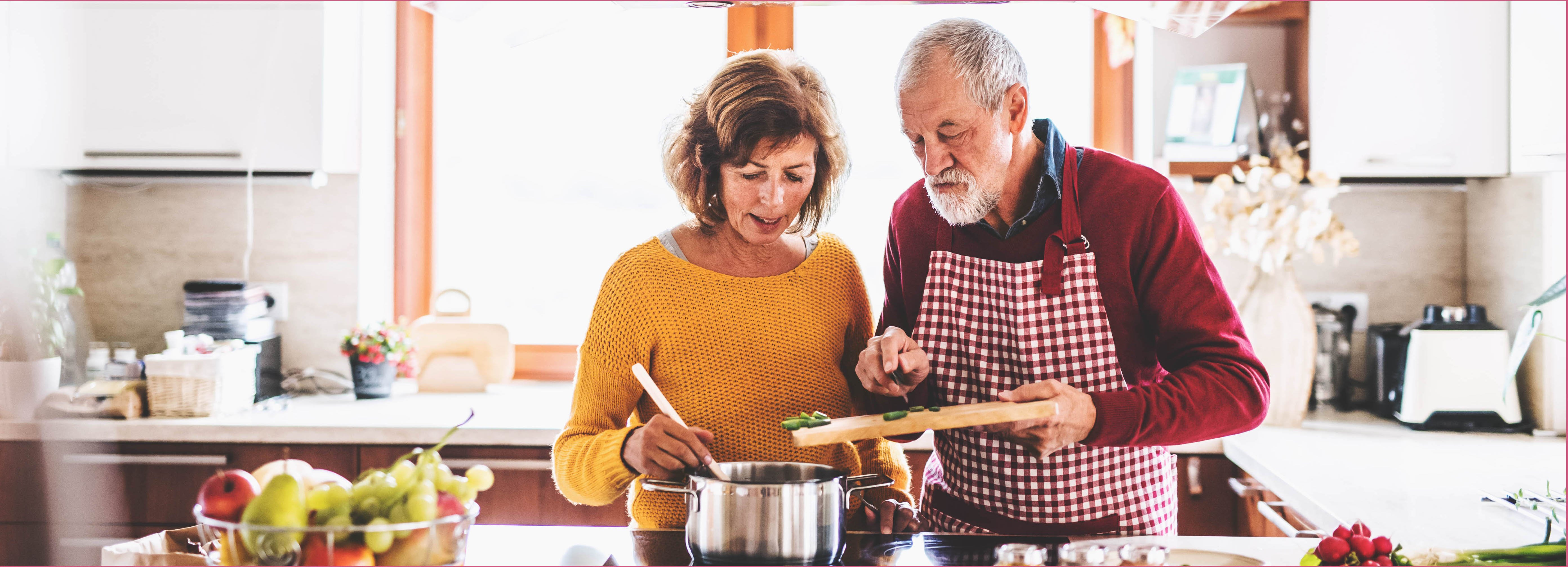 elderly couple cooking