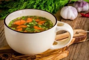 Bowl of Chicken Vegetable Soup with Kale
