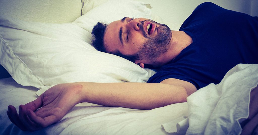 Person snoring or sleep apnea.