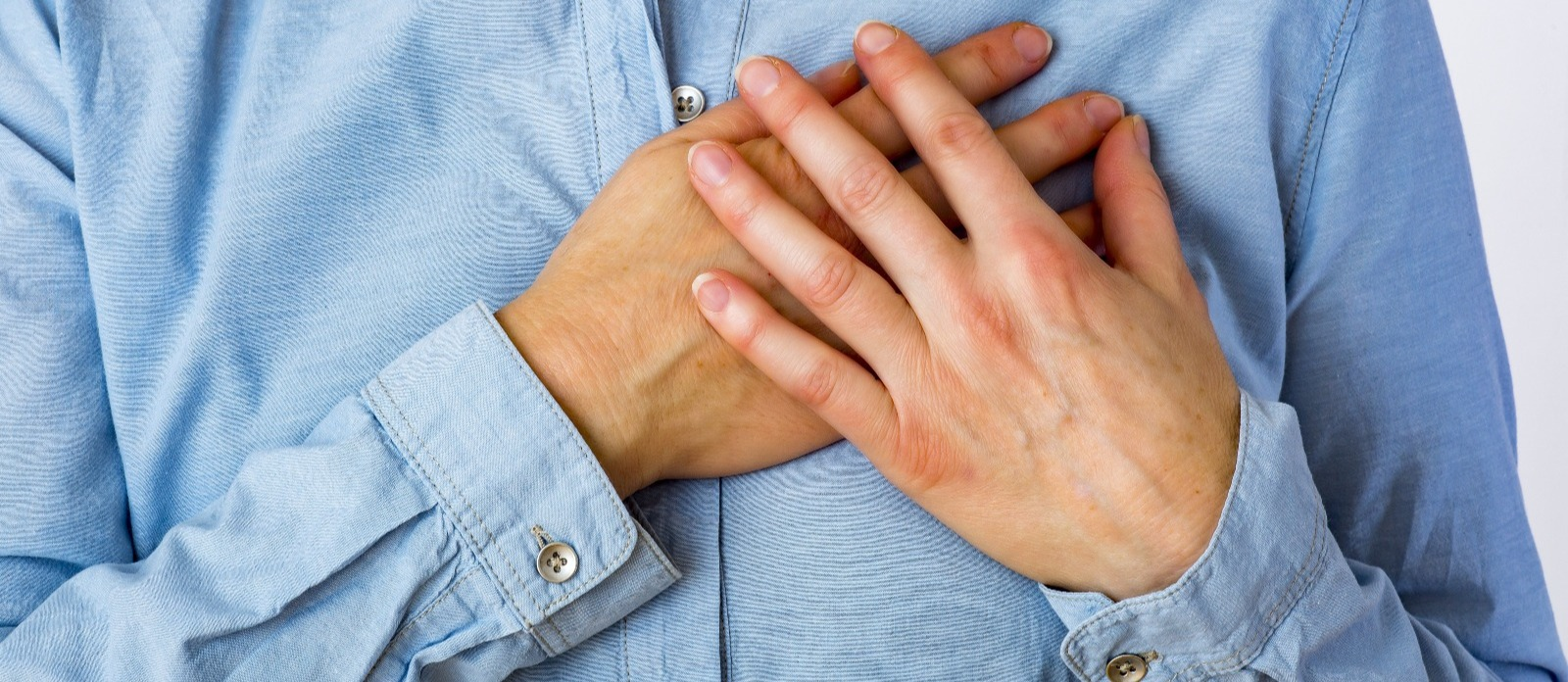 Person with hands over heart
